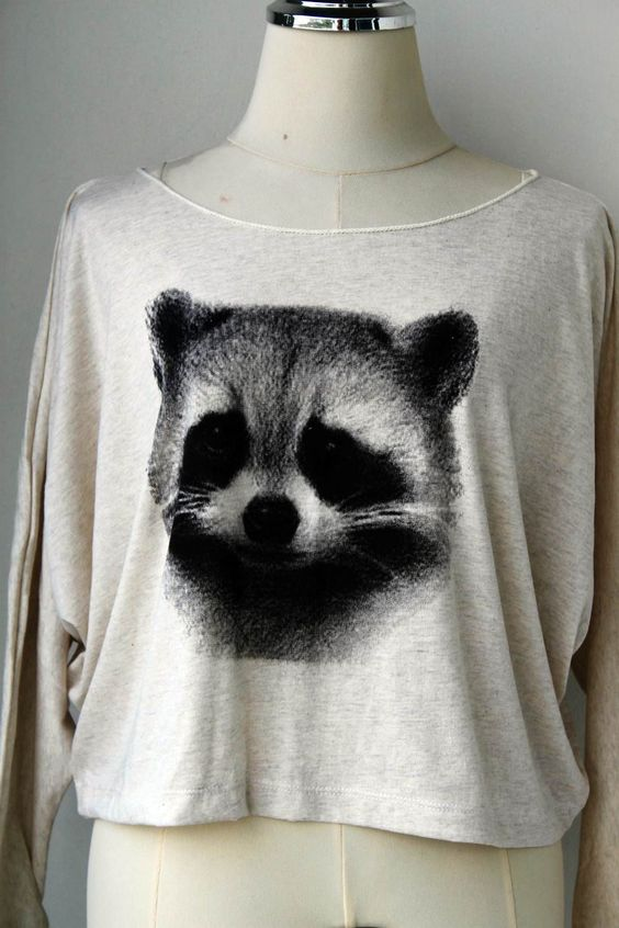 The Cute Pullover Long Sleeve Black Raccoons  Animal Print Bat Style Half Body In Cream.