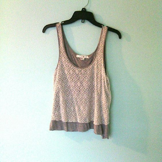 Absolutely ADORABLE grey and white lace tank top Grey tank top with a beautiful white lace overlay and a cute open back!! NEVER WORN and in very very good condition!  ⚡⚡I ACCEPT OFFERS⚡⚡ ⚡⚡WILLING TO BUNDLE⚡⚡ Forever 21 Tops Tank Tops