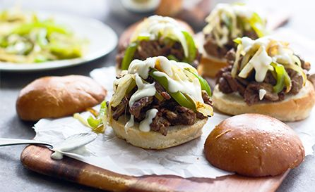 Created by: Nicole Leggio, Cooking for Keeps The classic combination of steak, sautéed green peppers and onions with melted provolone cheese in an adorable little slider.