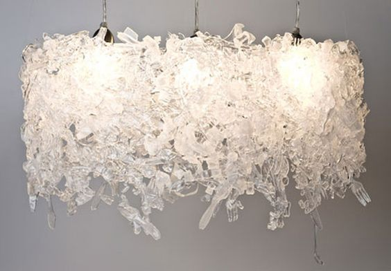 Chandelier made out of recycled plastic flatware...so crazy I lerv it!