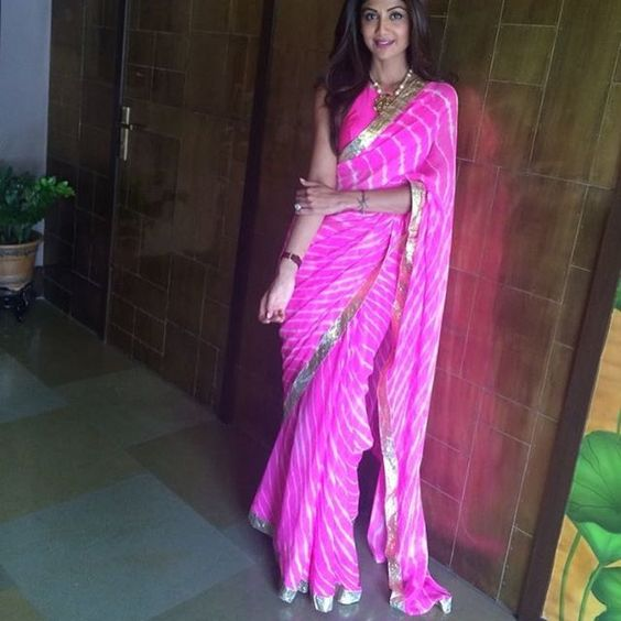 """""""She is a perfect muse to any saree designer pink lehriya saree worn by shilpa shetty is a must have in your wardrobe for this feative season. #sari #saree #sarees #sequin #silver #traditional #ThePhotoDiary #traditionalwear #india #print #instagood #indian #indianwear #indooutfits #like #pink #lehriya #shilpashetty #festive #floral #fashion #fashionblogger #houseof2"""" Photo taken by @house_of_2 on Instagram, pinned via the InstaPin iOS App! http://www.instapinapp.com (09/24/2015)"""