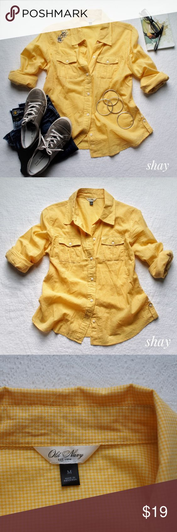 Yellow Gingham Button Down Soft, light weight, well made... the perfect shirt!  This has quality written all over it. Heck, even the tag is classy. 😜 Seriously, Old Navy and Gap really know how to design a button down. This yellow gingham will just pop against some dark denim shorts. It has tabs on the sleeves for rolling but I never use them myself. I just roll and tuck the tabs back into the sleeve.  This one is a must have basic. Old Navy Tops Button Down Shirts