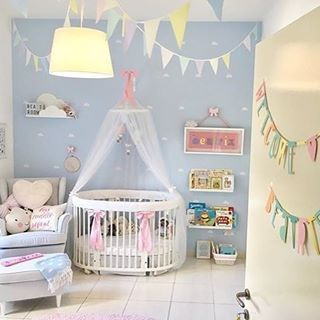 A perfectly pastel playspace and nursery for baby - swooning over the oval crib!