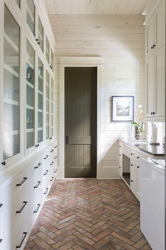 Brick Pavers in the Mudroom + Herringbone brick floors + Dark Olive Green Painted Door + Bleached Wood Shiplap Walls | Urban Grace Interiors