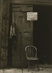N. Jay Jaffee (American, 1921-1999)    Chair with Sign, Livonia Avenue, Brooklyn, 1950        Gelatin silver print      9 1/2 x 6 5/8 in. (24.1 x 16.8 cm)      The Jewish Museum, New York