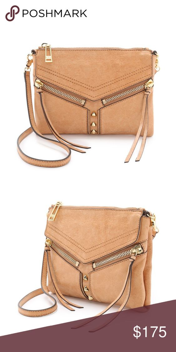 Super cute cross body bag! Got this bag as a gift and I love it but have something just like it. You can use it as a clutch or attach the strap and wear as a cross body. Super functional and cute! Botkier Other