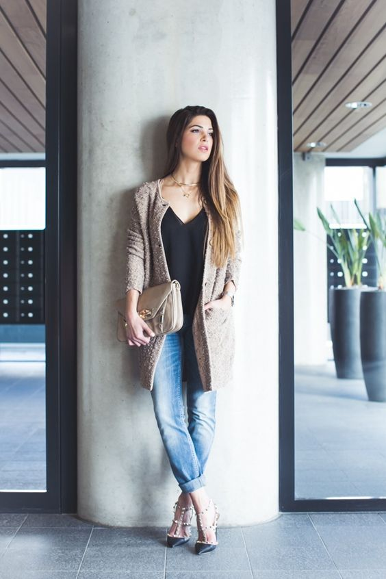 Negin Mirsalehi pairs her J BRAND Lucy Camisole in Black with a mauve coat.