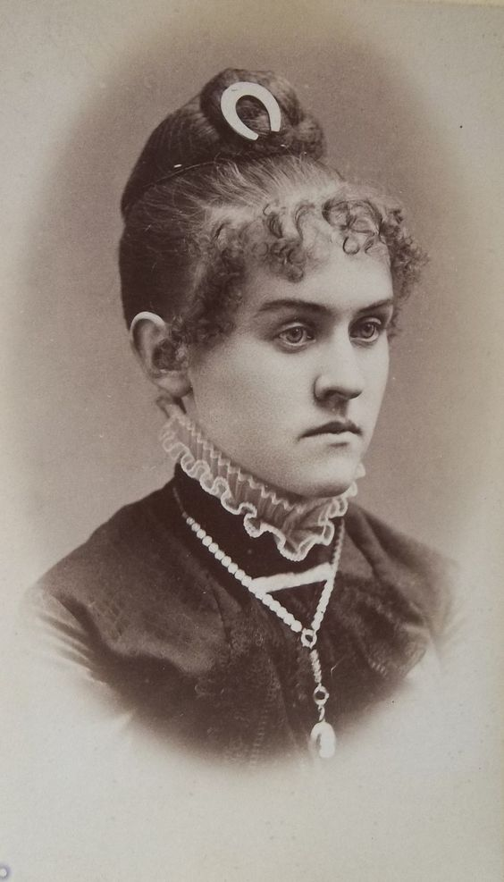 Victorian carte de visite showing sitter with crescent hair pin