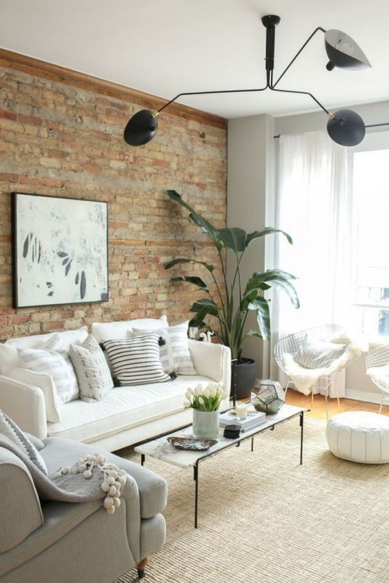A Neutral Living Room With Potted Greenery Black Touches And An Exposed Brick Wall For Brick Wall Living Room Brick Living Room Exposed Brick Wall Living Room