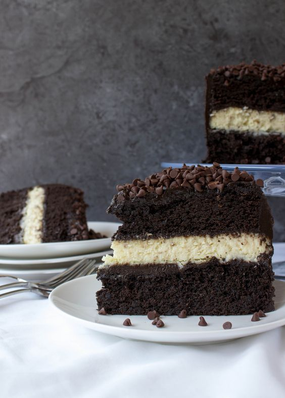 Cheesecake stuffed dark chocolate cake--classic cheesecake layered between two fudgy dark chocolate cakes and iced with dark chocolate cream cheese frosting