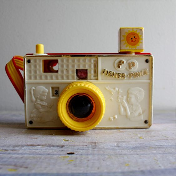 Vintage Fisher Price Camera: a perfectly analogue fisher price picture story camera. viewfinder has a changeable color wheel for cool effects and pressing the 'shutter' button changes the scene which features animals, farm and nature scenes. inspire a young photographer!