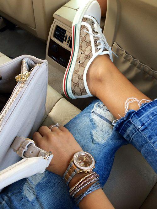 Ripped jeans gucci low top sneakers pastel handbag watch bracelets.