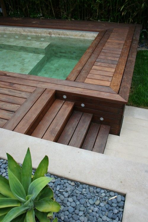 Love the wood lights and tile ideas for a salt water for Above ground pool decks with hot tub