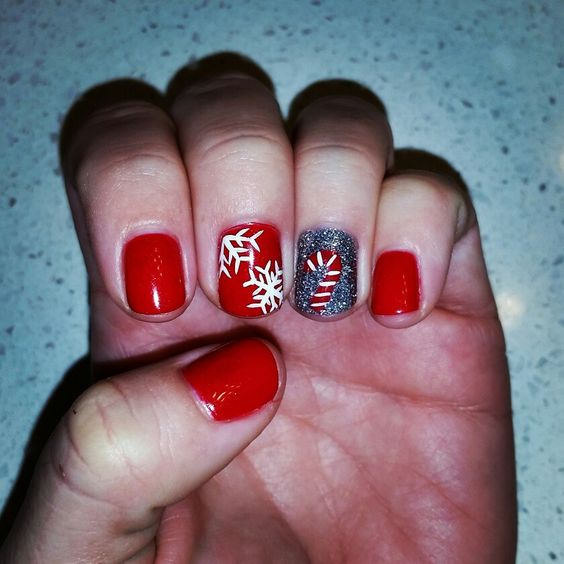 Holiday nails, red gelish, silver glitter, snowflakes n candy canes :)