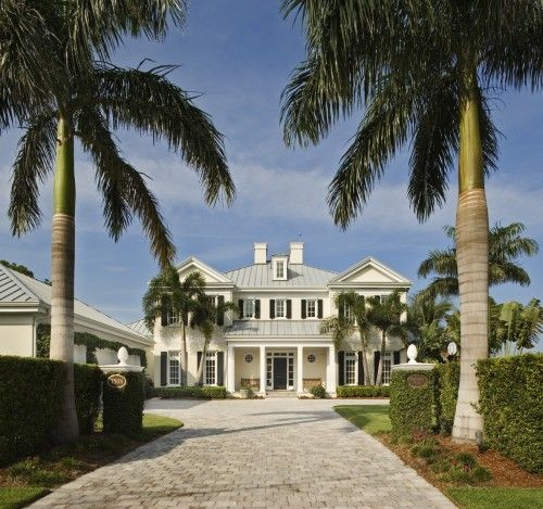 Traditional waterfront with a metal roof twist in Sarasota, FL. Clifford M. Scholz Architects.