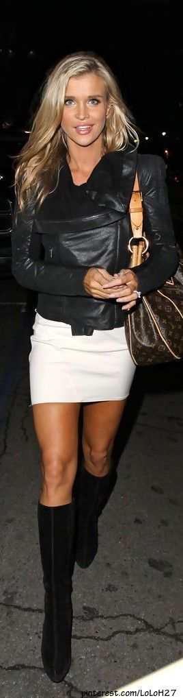 White skirt, black leather coat with knee-high heels. JK knows