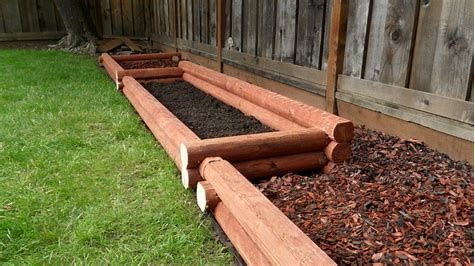 Landscape Timber Edging Is Simple To Mount And Also Creates An Attractive Natural Looking Structure For A B Landscape Timbers Landscape Timber Edging Backyard