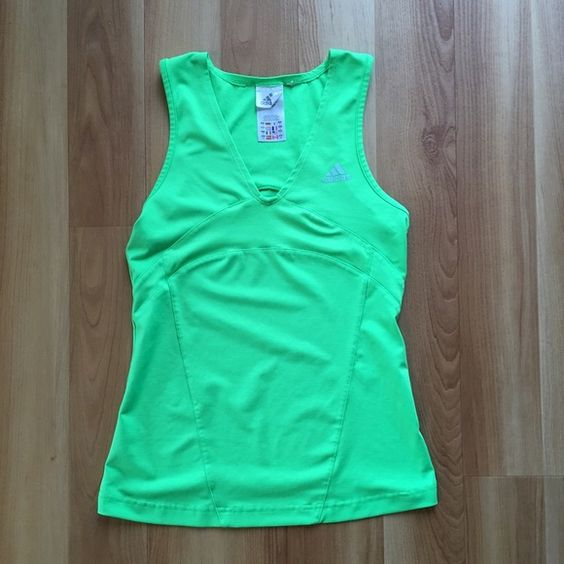 Women's green Adidas athletic top Women's small green Adidas athletic top. Whether you're tying to get back into working out or keeping it going, this top is perfect to help you reach your athletic goals! Adidas Tops