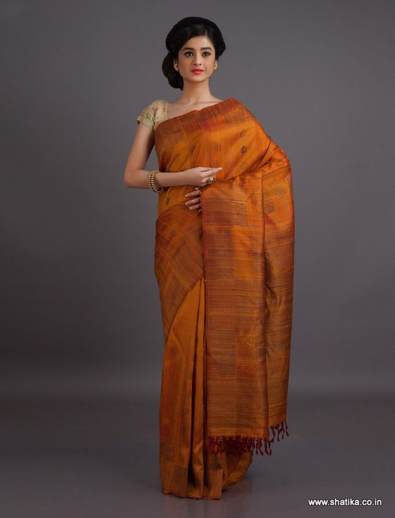 Woven in the plain concepts of Gadwal silk, this earthen Gadwal saree is rooted to tradition. Gadwal sarees are renowned for admirable zari patterns and well-crafted pure silk kuttu borders and pallus. Exhibiting a remarkable trait of getting folded down to the size of a matchbox, our Gadwal Silk Sarees online have demand throughout the country.