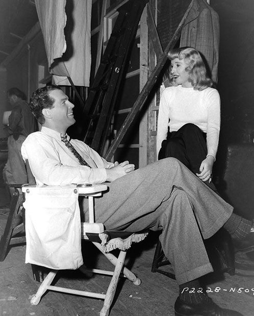 """Fred MacMurray and Barbara Stanwyck between scenes of """"Double Indemnity"""" [1944]:"""