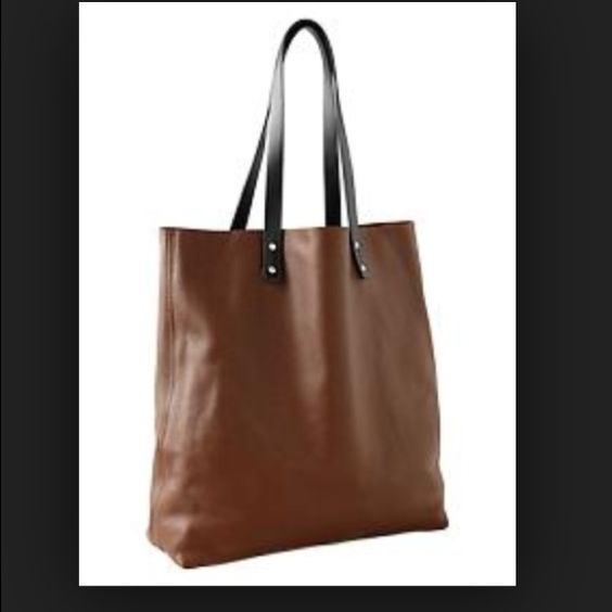 """GAP -  Leather Tote ❌NO TRADING ❗️NWT.                                                                                                            Handles: Polyurethane Body: Leather Color: Cognac Smooth grained leather. Contrast faux leather top handles. Interior side zip pocket. Flat base, Unlined. LWH dimensions: 13"""" x 5"""" x 14.5"""", 33 x 13 x 37 cm GAP Bags Totes"""