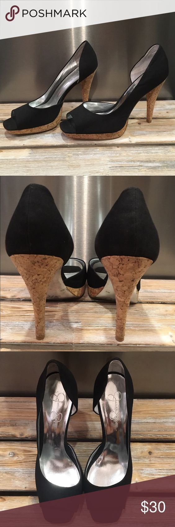 Jessica Simpson peep toe pumps Jessica Simpson peep toe pumps are adorable with the cork bottom.  The black is fabric and is in perfect condition and so is the cork.  After having kids these no longer fit me 😢 size 9 Jessica Simpson Shoes Heels
