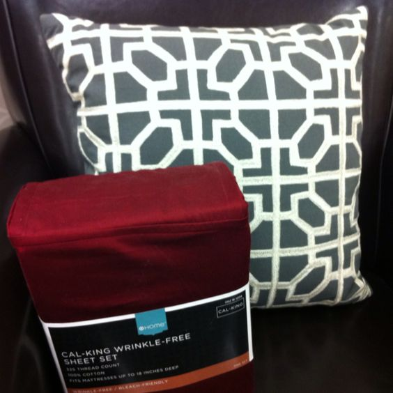 Dark gray and cream patterned accent pillow, dark red sheet set. Target.