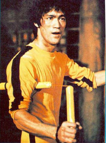 Bruce Lee's yellow jumpsuit with black stripes is one of the most ...
