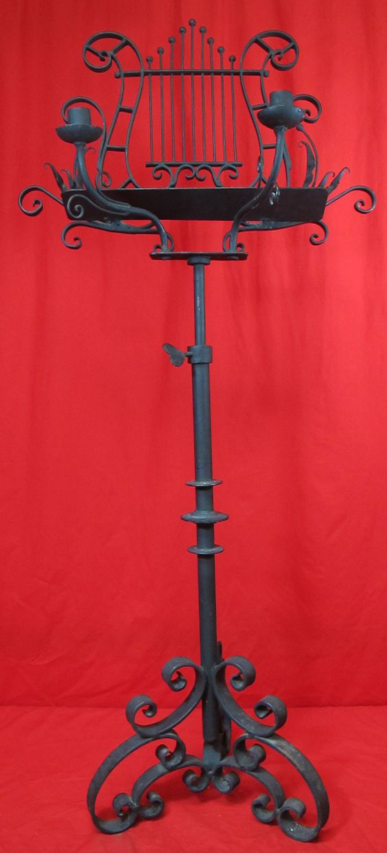 ..I want my private violinist to serenade me whilst using this candelabra slash music stand. Haha
