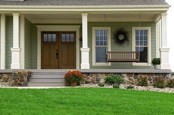 Beautiful double doors and a porch swing as a welcoming for Pictures of beautiful front porches