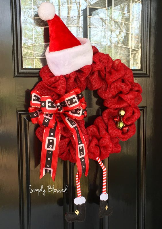 Adorable Santa Wreath! Santa with Hat, Bendable Legs, and Bells Approximately 20 inches wide x 30 inches long