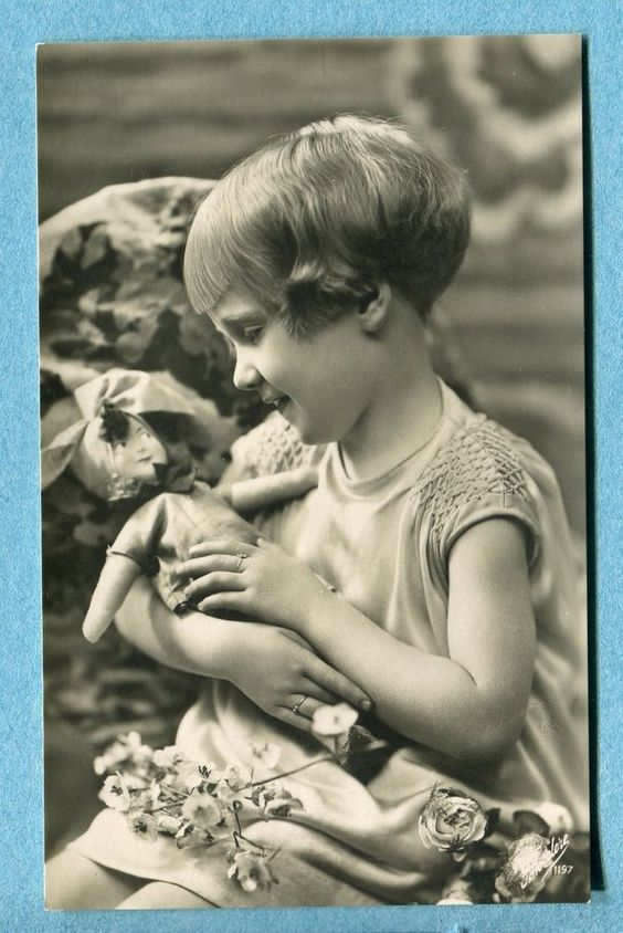 X5020 Real photo postcard of girl with fashion doll, Italian