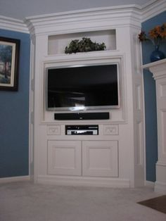corner entertainment center - like how it's built out of the wall.