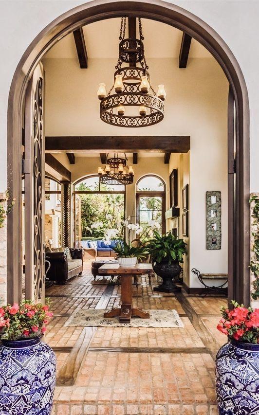 Brick flooring Mediterranean style decor and chandelier