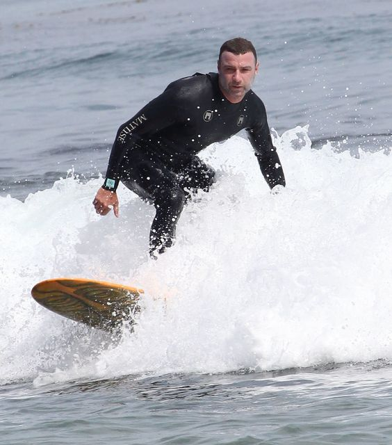Liev Schreiber can give us surfing lessons anytime.
