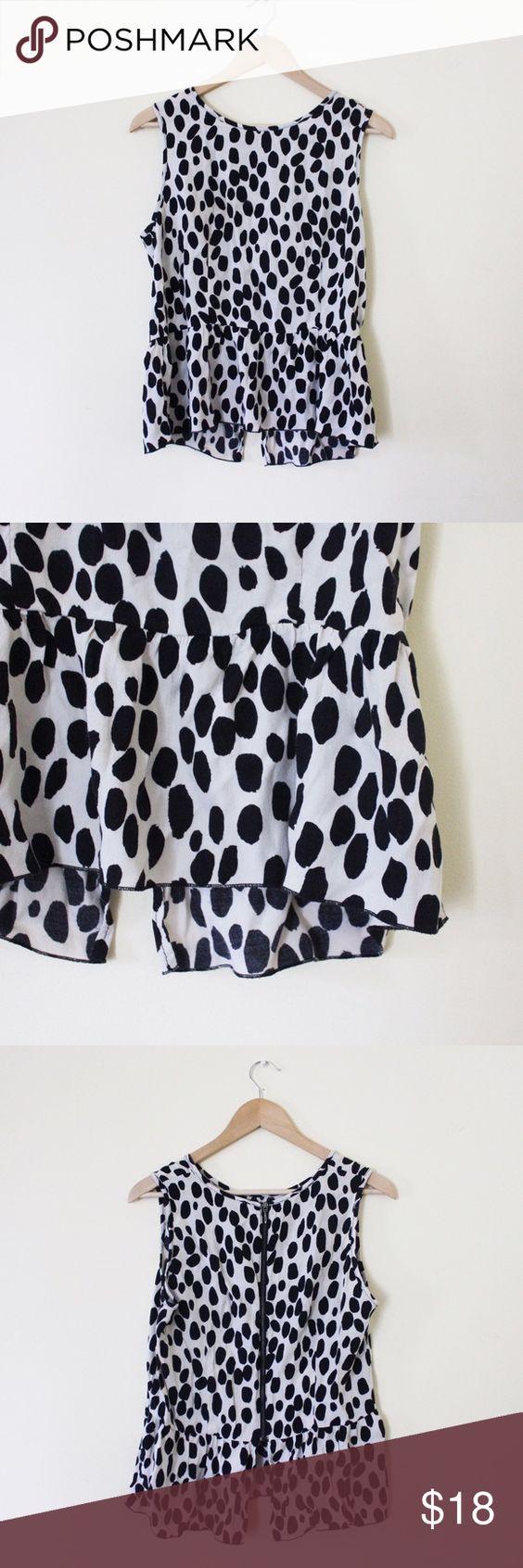 Polka dot blouse Peplum polka dot blouse. Back zipper. Good condition! Size 12, but closer to an 8/10. H&M Tops Tank Tops