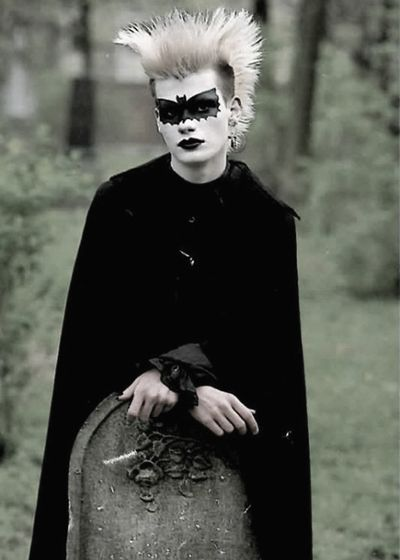 Germany, 1989, Punk guy in a cemetery  with fabulous bat face paint.