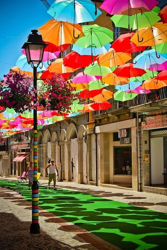 Umbrellas float above the street in Agueda, Portugal.