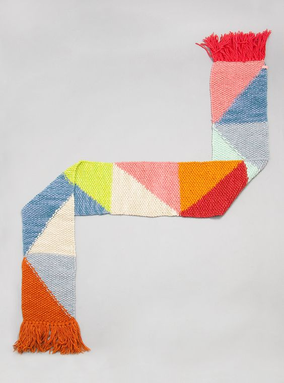 Hand knitted tassel scarf by Ikou Tschuss