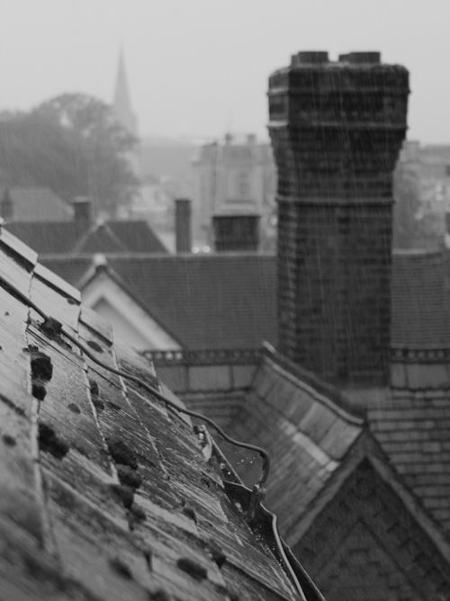 unirdg-collections:  It never rains but it pours here in Reading. This is the view over our London Road campus rooftops toward the town centre. Hopefully anyone arriving today for Reading Festival brought their wellies..