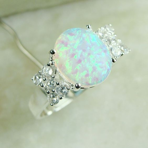 I love Opal!!! :') This reminds me of the ring that Todd gave Christy :'D in the Christy Miller series by Robin Jones Gunn. I officially want an opal engagement ring.