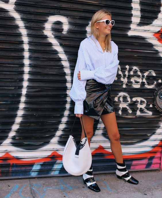 Camille Charrière in a Tome shirt, Isabel Marant skirt, and Dorateymur boots