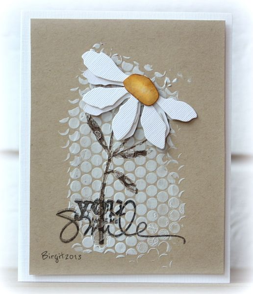 hand crafted card from Birgit ... dots stenciled on for background texture in the middle of the card ... die cut daisy top on stamped stem ... sentiment of top of that ... kraft base ... delightful ...: