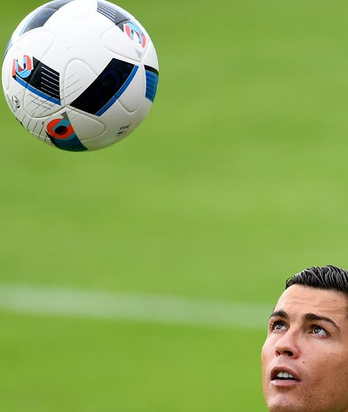 #EURO2016 Portugal's forward Cristiano Ronaldo plays with the ball during a training session at the team's base camp in Marcoussis south of Paris on June 24 on...