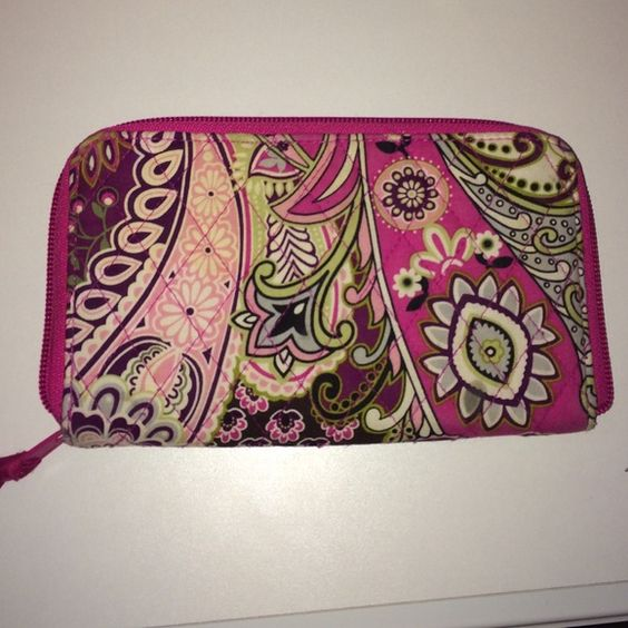 Vera Bradley wallet Used but in good condition. Comes from a smoke free home. ID holder. 7 card holders. 2 pockets. Zip pocket on outside. Vera Bradley Bags Wallets