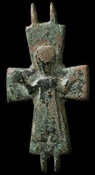 "Byzantine Empire, 8th-11th century AD. Bronze half of a reliquary cross. Christ with arms upraised ""Orans"", wearing Medieval garments."
