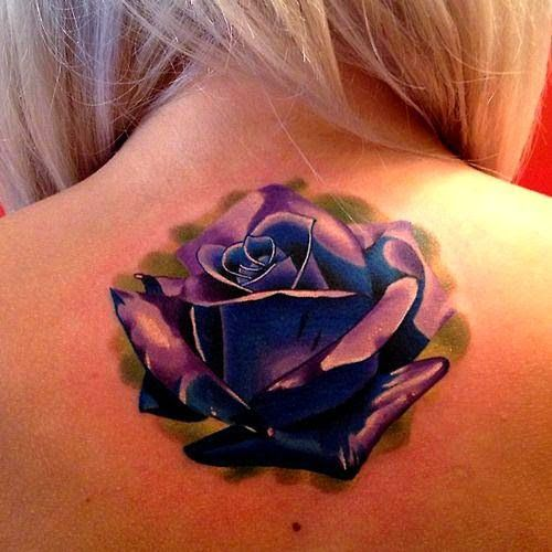 Violet and blue color rose flower tattoo design on upper ...
