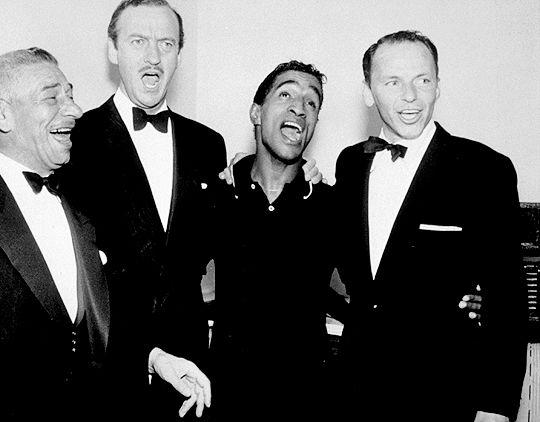 Mike Romanoff, David Niven, Sammy Davis Jr., and Frank Sinatra, c ...