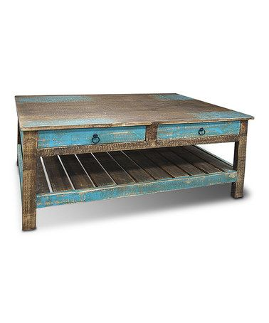 Casamia distressed teal stanley cocktail table teal for Teal coffee table