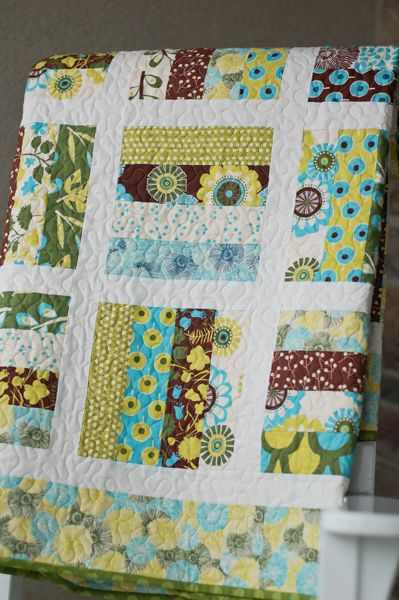 "all things simple: shauna's quilt. 8 X 8 "" blocks; jelly roll strips with 1.5"" sashing. Border is 4"".:"